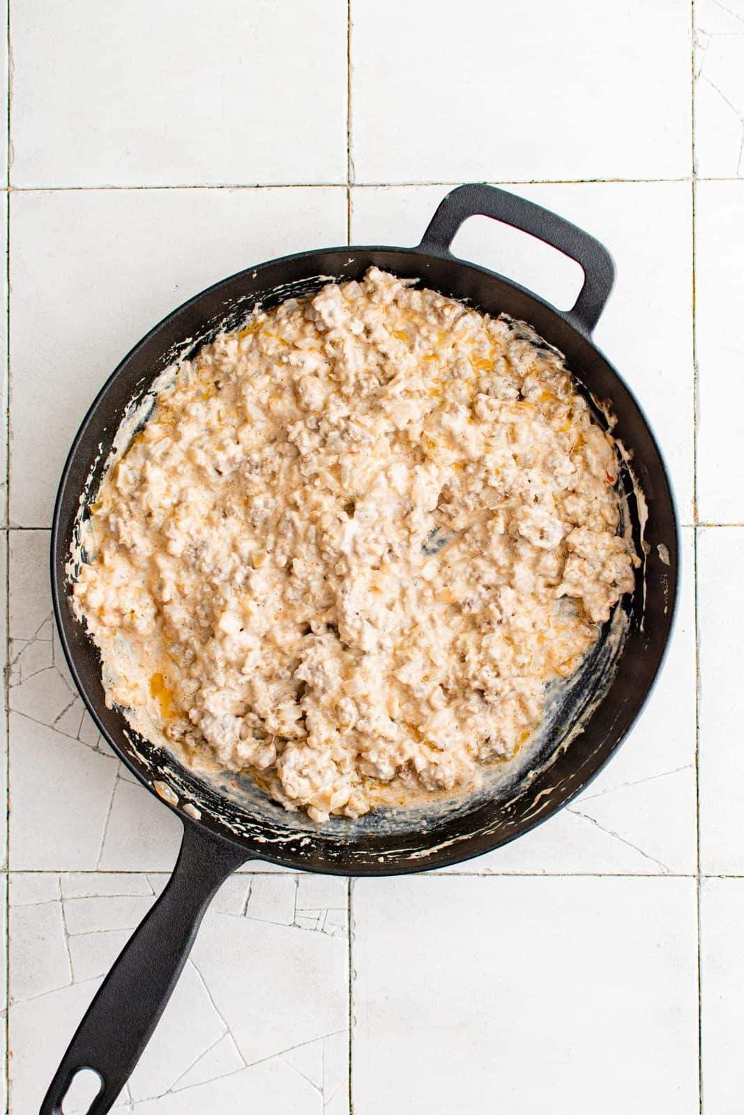 Pie filling ingredients mixed together in pan.