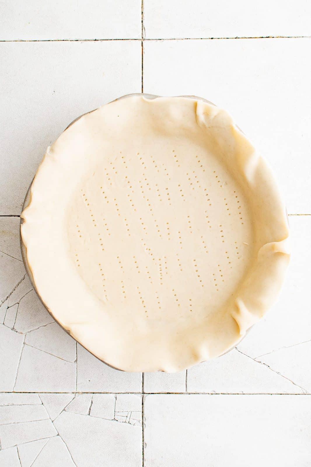 Pie crust in pie plate.