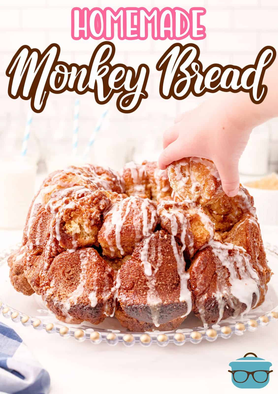Homemade Monkey Bread on platter with hand reaching for piece Pinterest image.