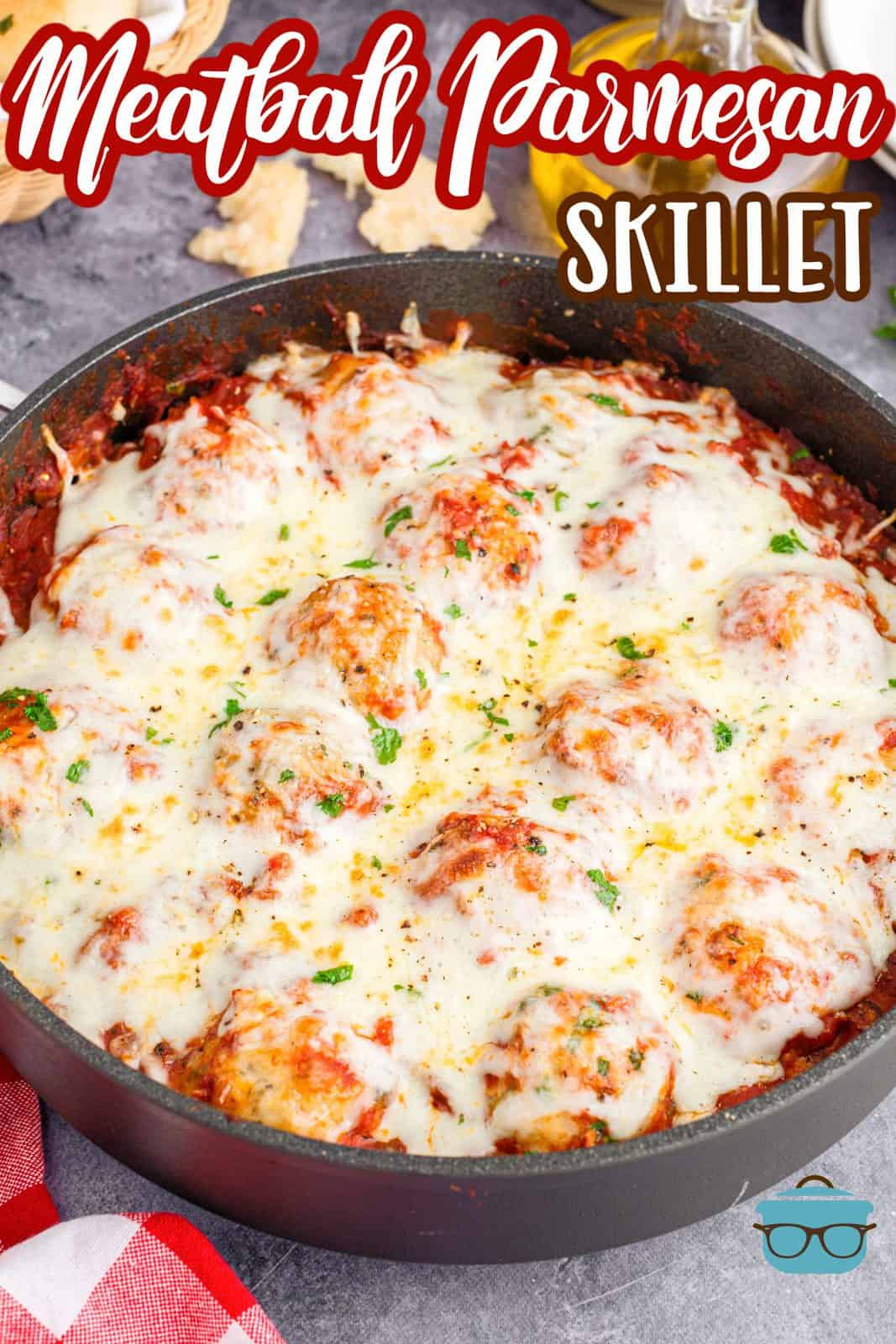 Pinterest image of Meatball Parmesan Skillet in pan topped with parsley.