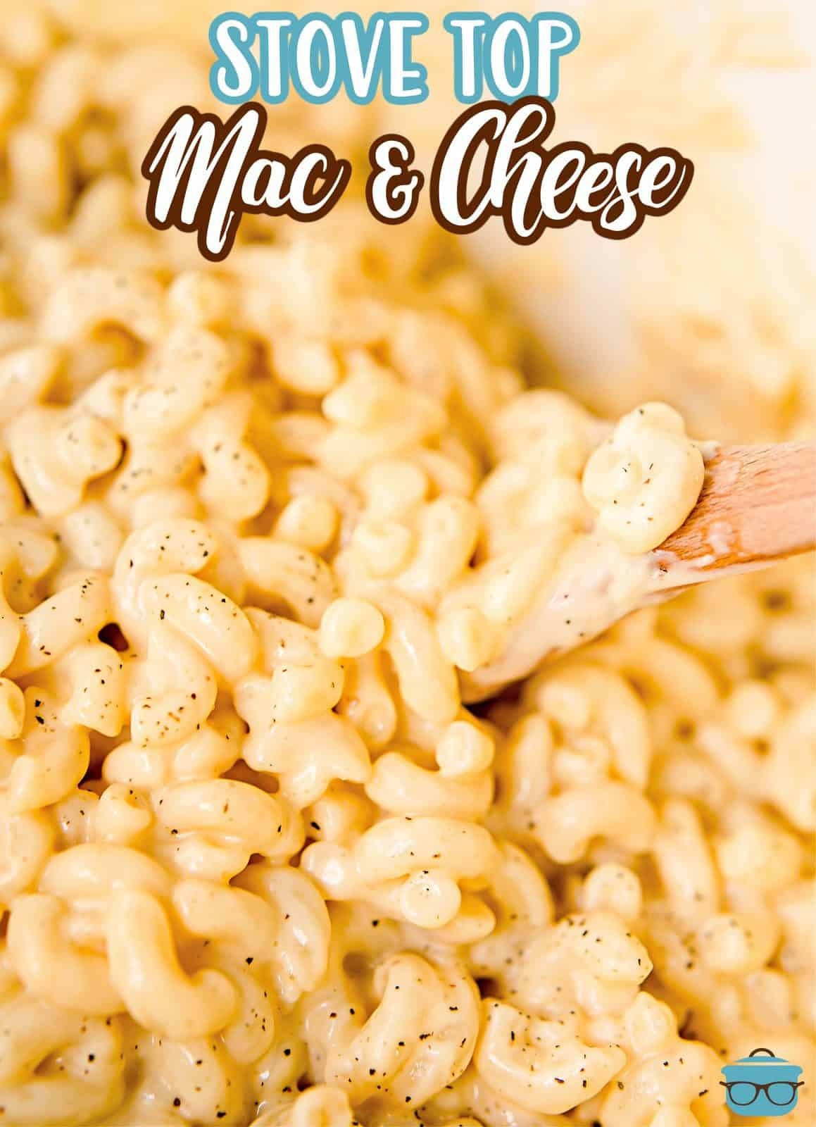 Pinterest image of finished Macaroni and Cheese being lifted with wooden spoon.