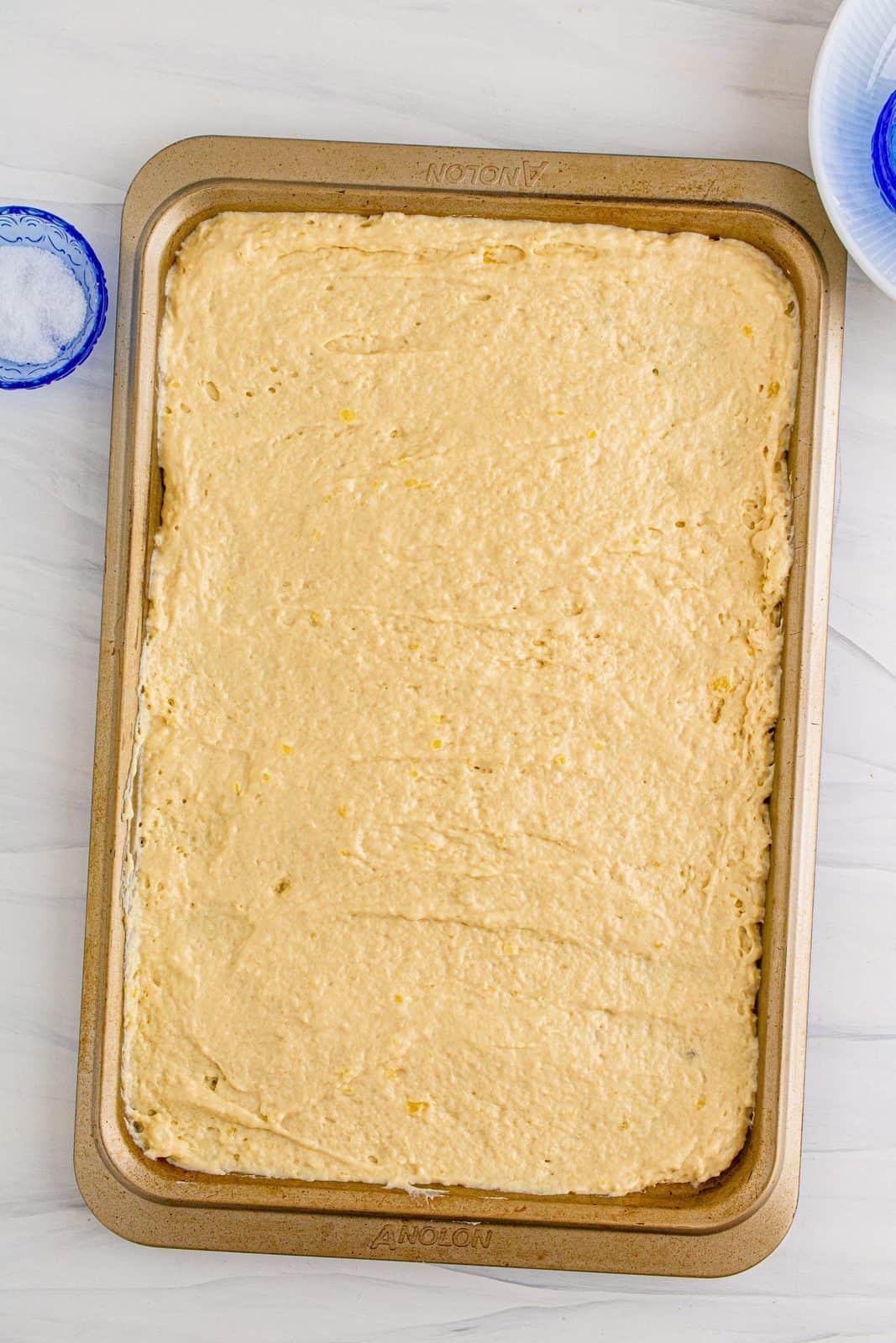 Pancake batter spread into sheet pan.
