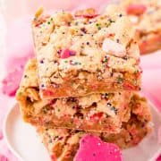 Square image side view of stacked Circus Animal Cookie Blondies.