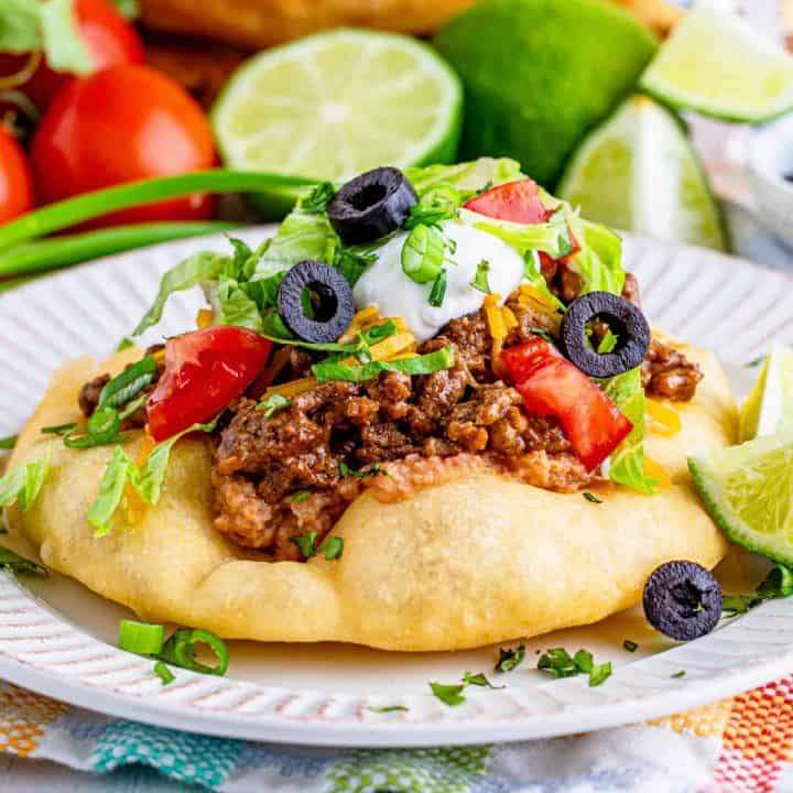 Square image of topped Fry Bread Taco.