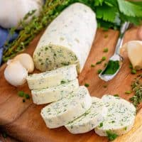 Square image of finished and sliced Garlic Herb Butter.