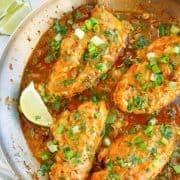 Square image of finished Salsa Verde Chicken in skillet.