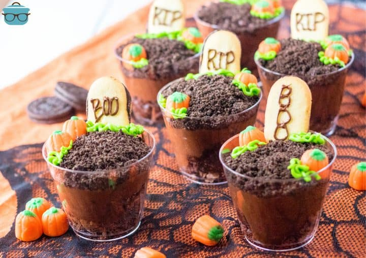 Horizontal images of finished Halloween Graveyard Cups on black lace fabric.