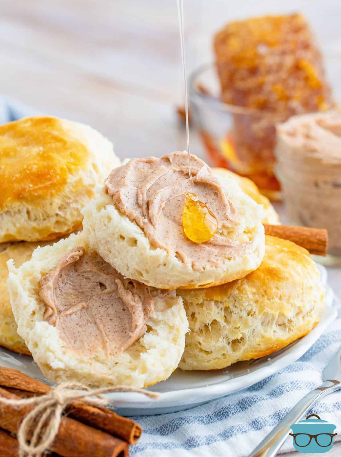 Split biscuits with Texas Roadhouse Cinnamon Honey Butter spread on with a drizzle of honey.