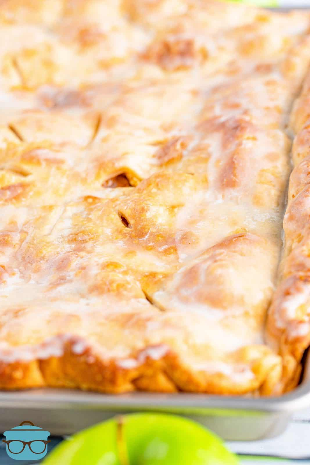 Finished glazed Apple Slab Pie in pan.