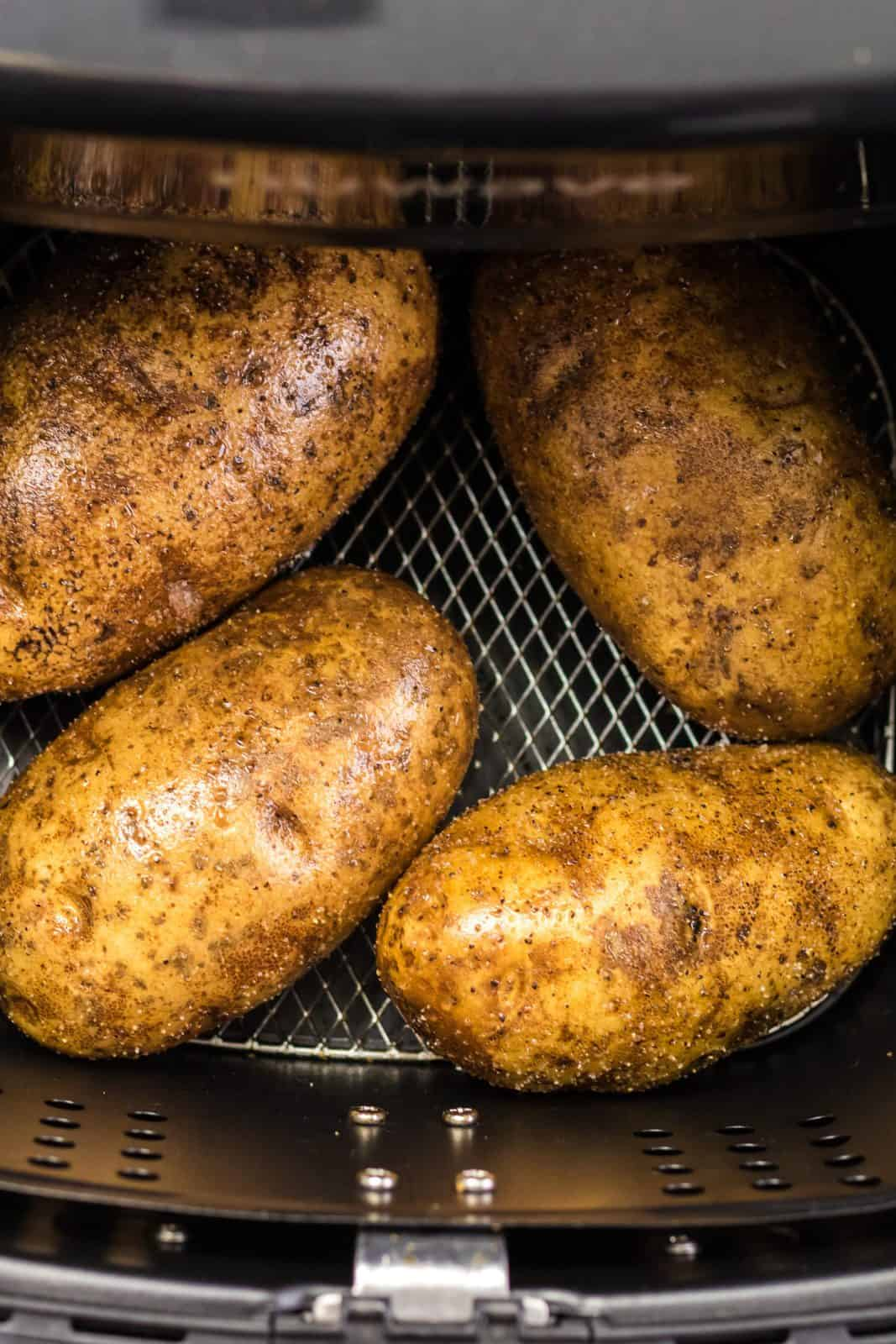 Baked Potatoes placed in air fryer.