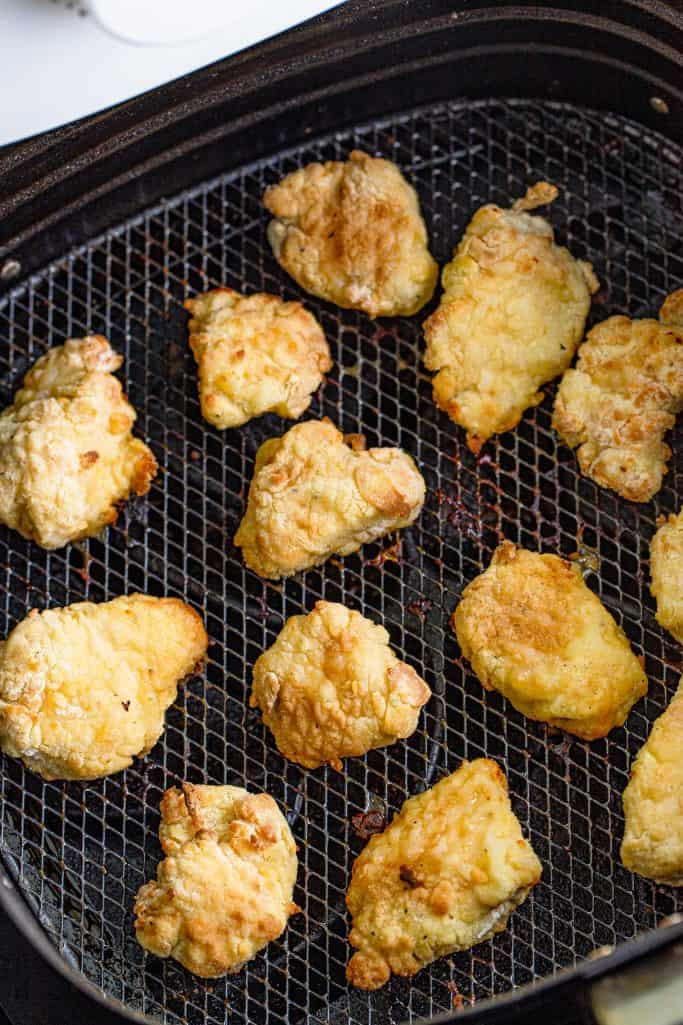 Finished Air Fryer Chick-Fil-A Chicken Nuggets in air fryer basket.
