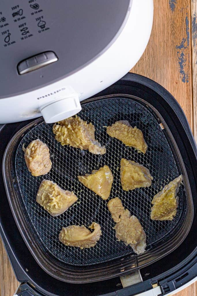 Chicken Nuggets added to air fryer and sprayed with cooking spray.