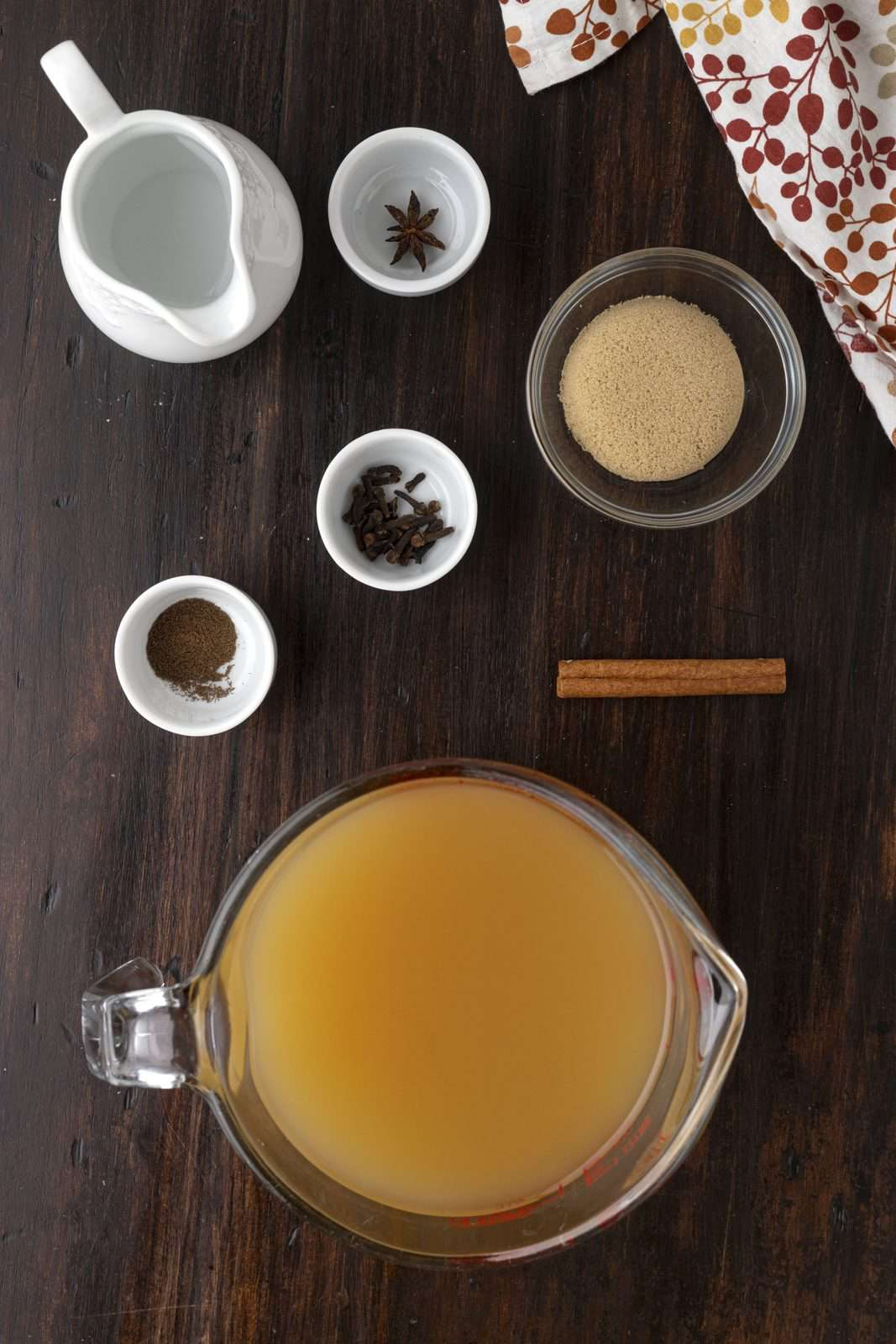 Ingredients needed: apple cider, brown sugar, cinnamon stick, star anise, whole cloves, allspice and vodka.