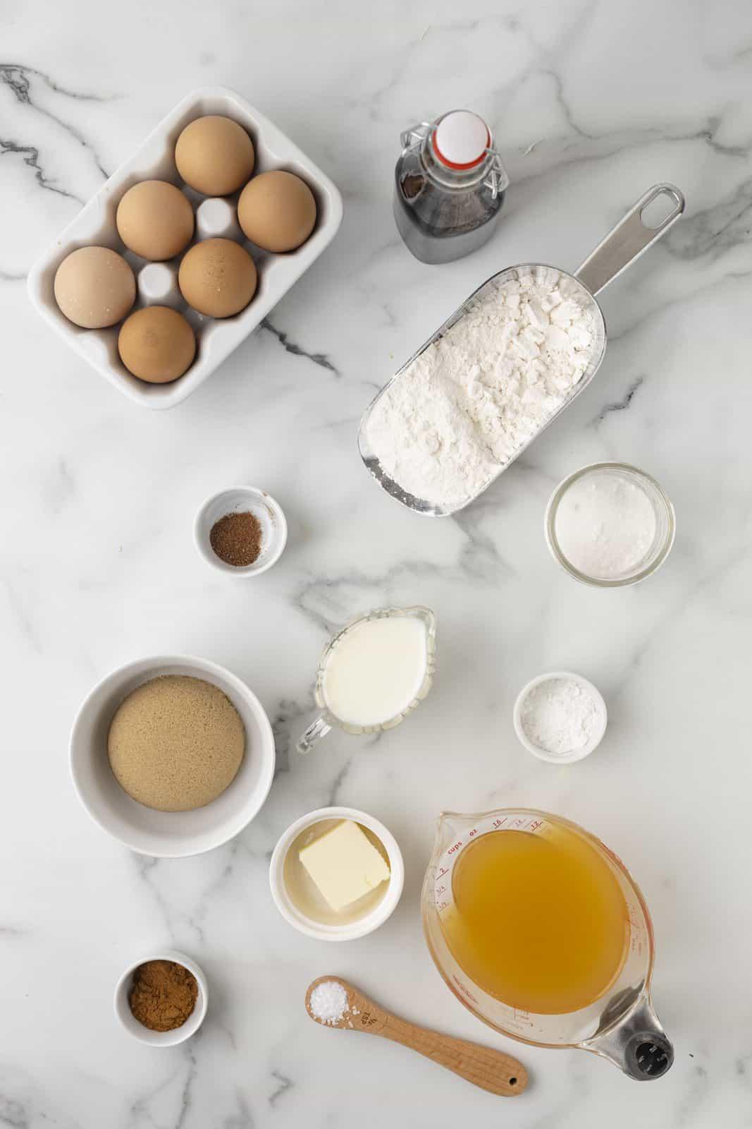 Ingredients needed: apple cider, cake flour, baking powder, cinnamon, salt, nutmeg, milk, brown sugar, granulated sugar, egg, unsalted butter and vanilla extract.