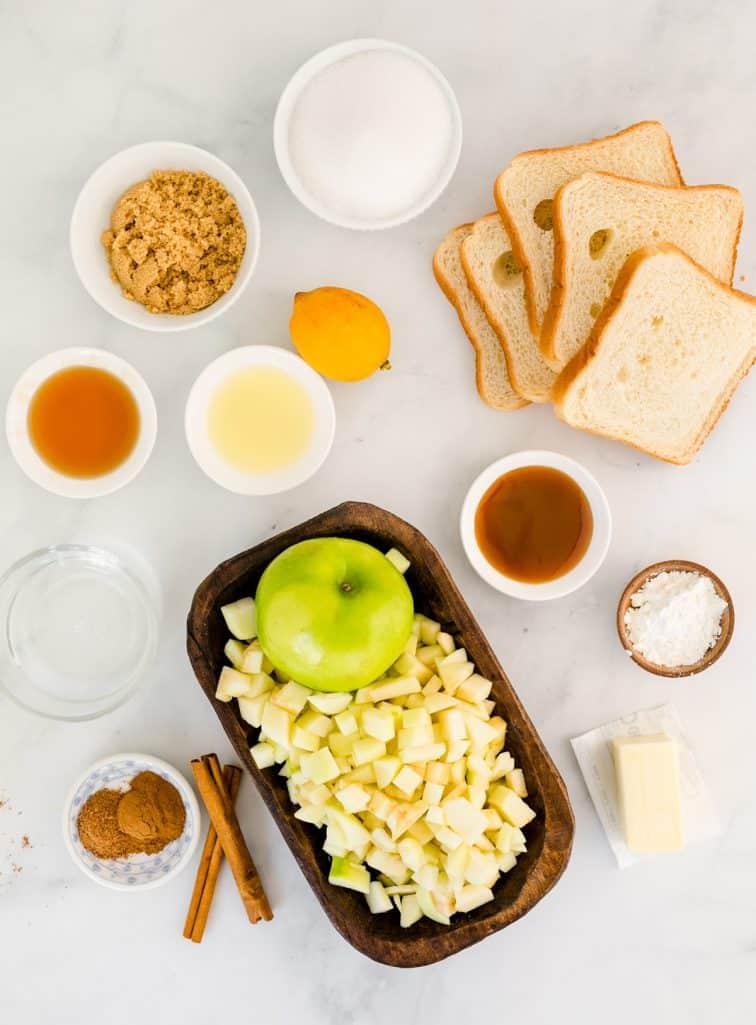 Ingredients needed: water, brown sugar, maple syrup, caramel syrup, lemon juice, cornstarch, apples, sandwich bread, granulated sugar, cinnamon, nutmeg and butter.