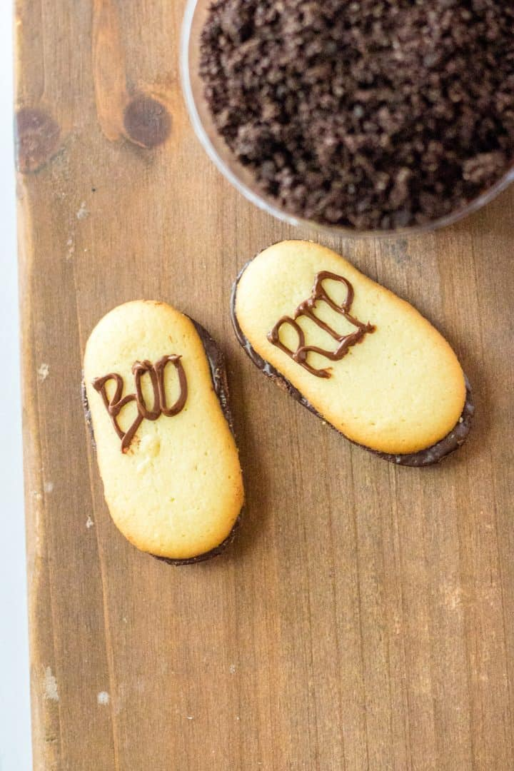 """The words """"Boo"""" and """"R.I.P"""" piped onto cookies."""