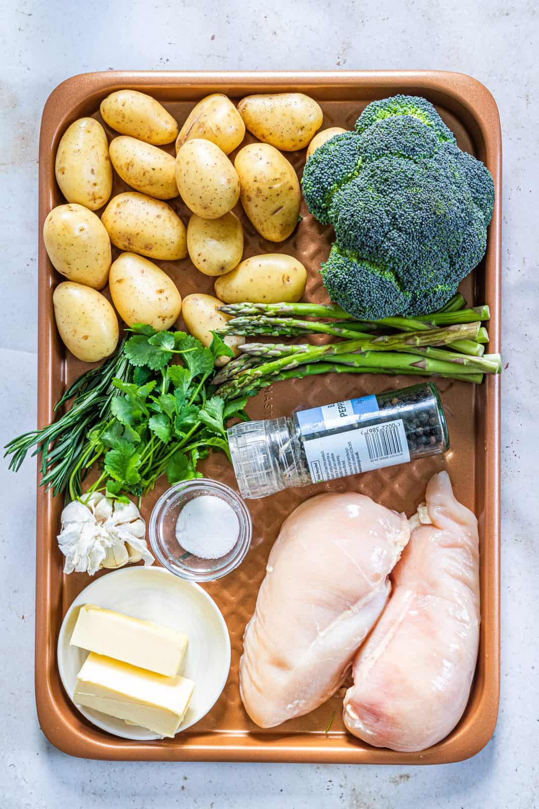 Ingredients needed: salted butter, garlic, parsley, salt, pepper, chicken breasts, baby potatoes, broccoli, asparagus and rosemary sprigs.