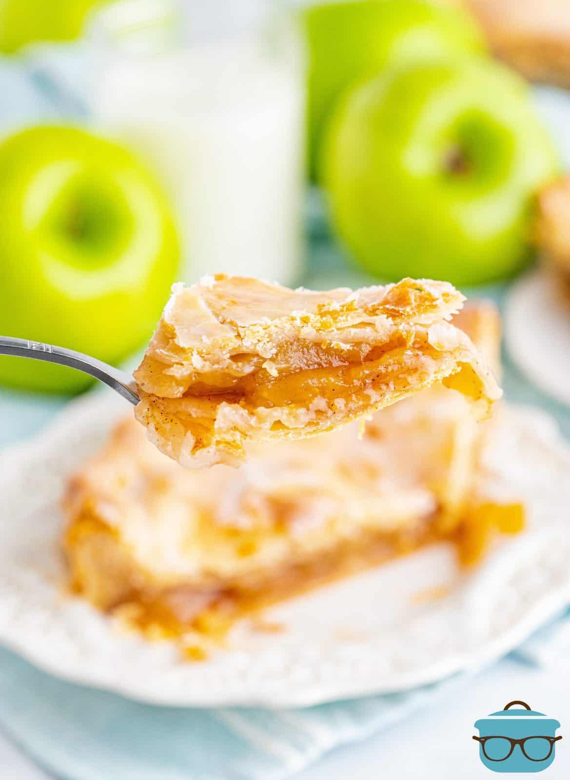 Fork holding up bite of Apple Slab Pie.