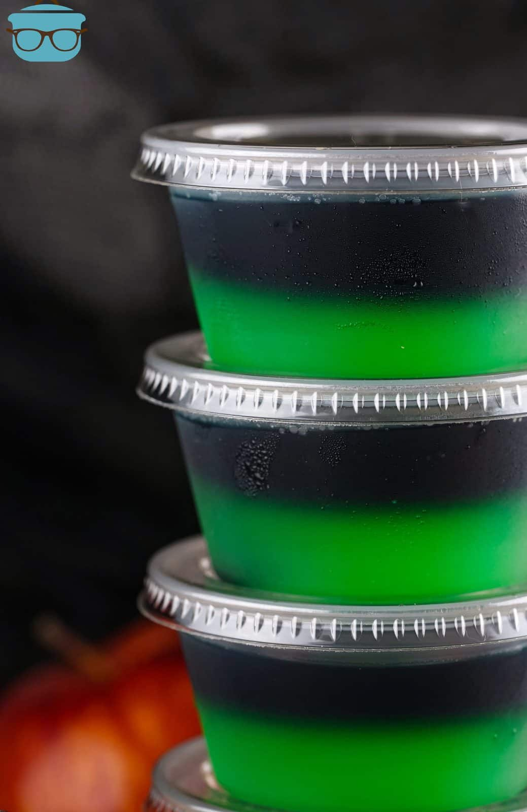 Close up of sides of stacked Halloween Poison Apple Jell-O Shots.