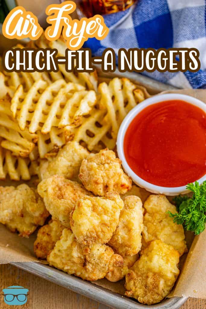 Pinterest image of Air Fryer Chick-Fil-A Chicken Nuggets on metal tray with Polynesian sauce and waffle fries.