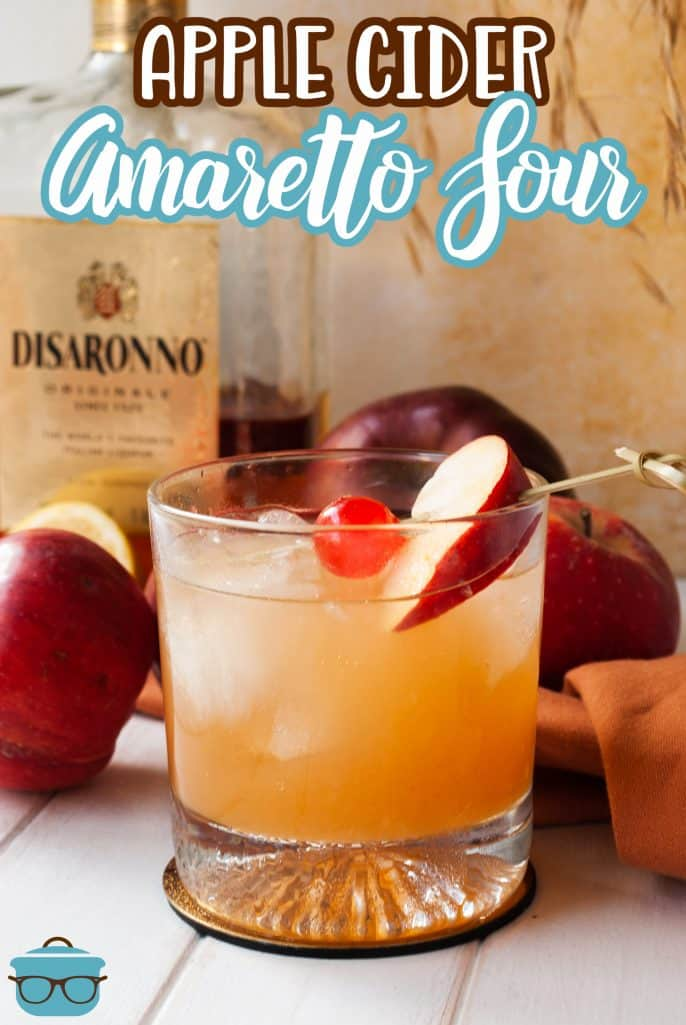 Pinterest image of finished Apple Cider Amaretto Sour garnished with cherry and apple slice.