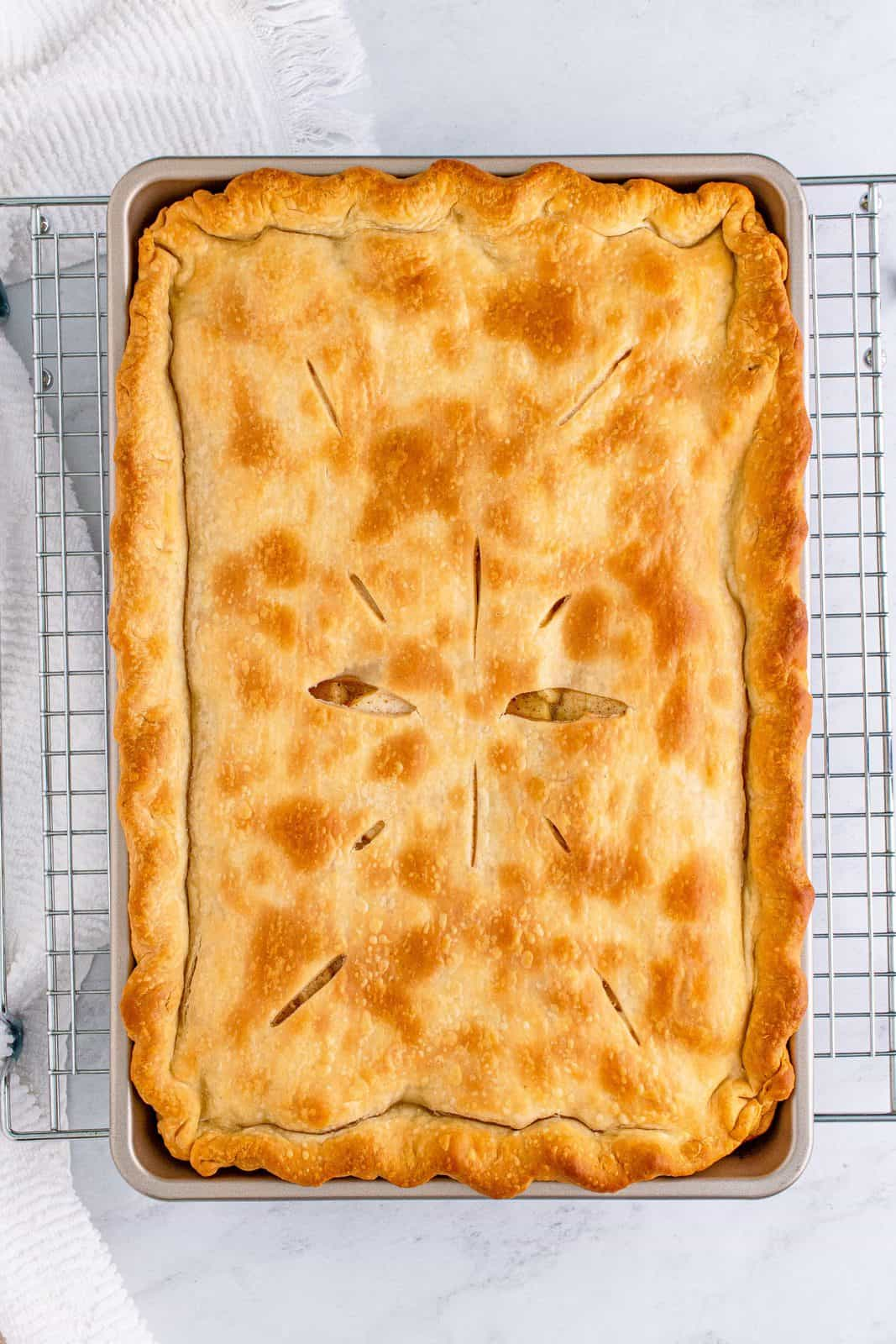 Baked Apple Slab Pie baked and cooling on wire rack.