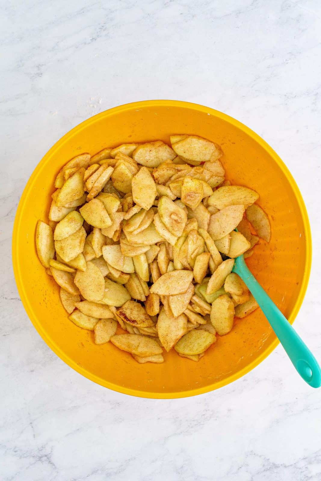 Apple mixture stirred together in bowl.