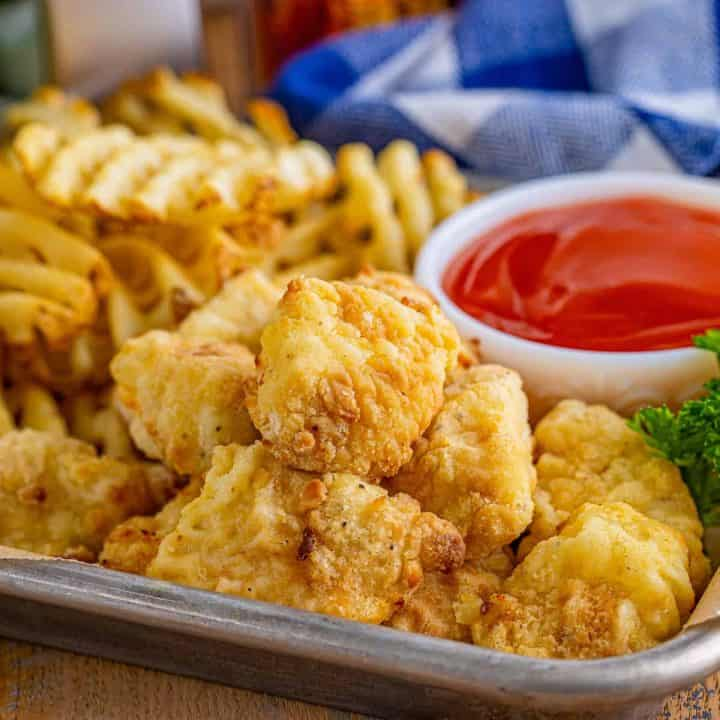 Square image of Air Fryer Chick-Fil-A Chicken Nuggets close up on metal tray with sides.