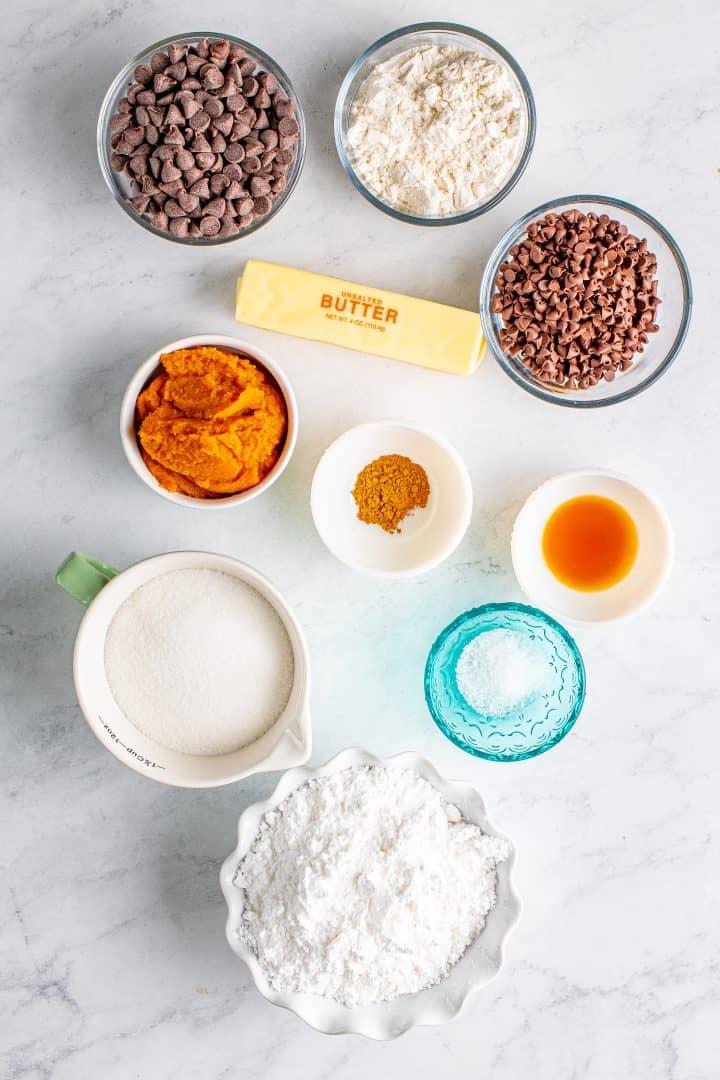 Ingrerdients needed: all-purpose flour, pumpkin pie spice, salt, unsalted butter, granulated sugar, powdered sugar, pure pumpkin puree, vanilla extract, semi-sweet chocolate chips and mini chocolate chips.