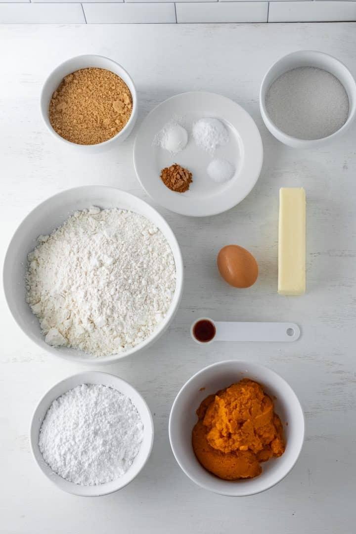 Ingredients needed: all-purpose flour, pumpkin pie spice, baking powder, baking soda, salt, butter, brown sugar, granulated sugar, egg, pumpkin puree, vanilla extract and powdered sugar.