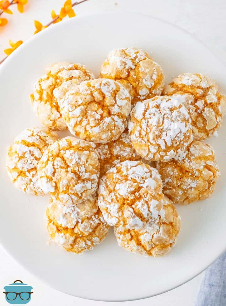 Overhead photo of stacked Pumpkin Crinkle Cookies on white plate.