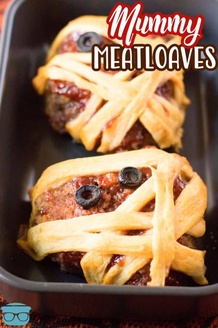 Pinterest image of finished and wrapped Halloween Mummy Meatloaves on black platter.