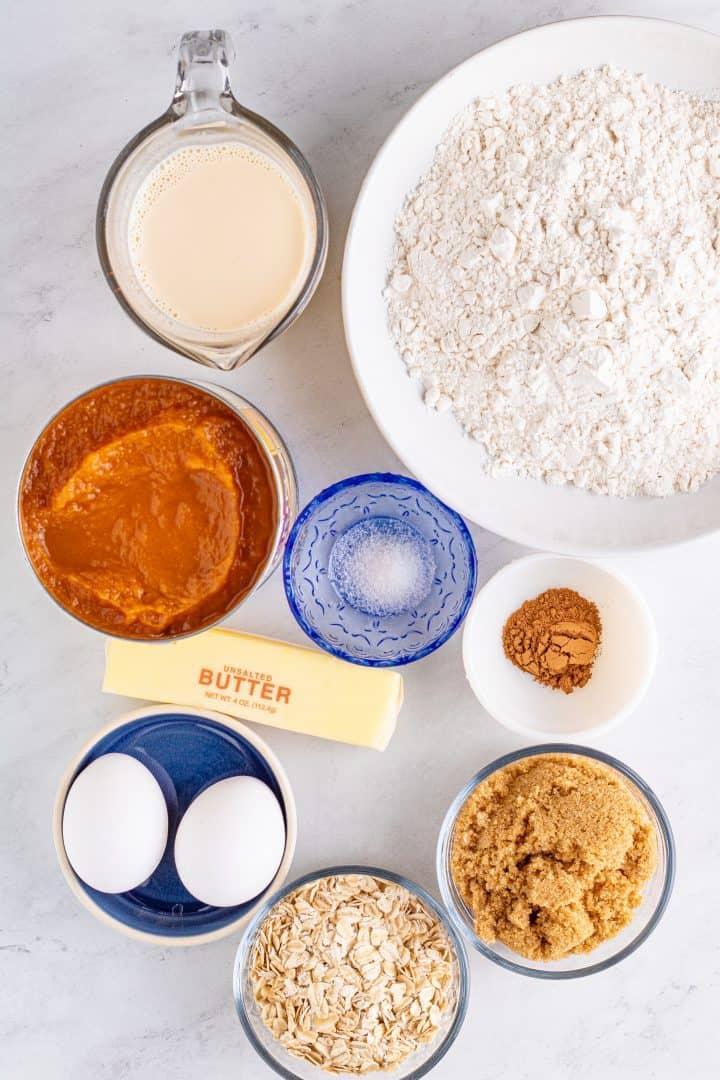 Ingredients needed: all-purpose flour, pumpkin pie spice, fine sea salt, unsalted butter, light brown sugar, pumpkin pie mix, eggs, evaporated milk, rolled oats, powdered sugar, whole milk and vanilla extract.